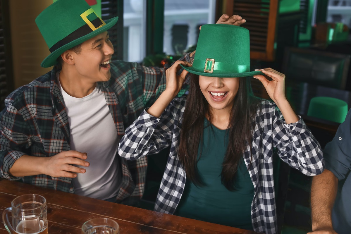 Young friends celebrating St. Patrick's Day in pub