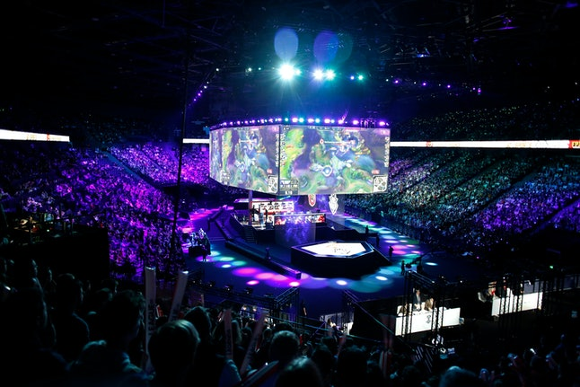 A general view during the final of League of Legends tournament between Team G2 Esports and Team FunPlus Phoenix, in Paris, . The biggest e-sports event of the year saw a Chinese team, FunPlus Phoenix, crowned as world champions of the video game League of Legends. Thousands of fans packed a Paris arena for the event, which marked another step forward for the growing esports business