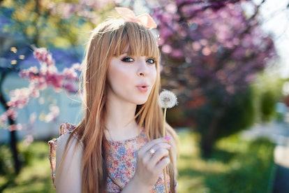 spring, girl near a flowering tree