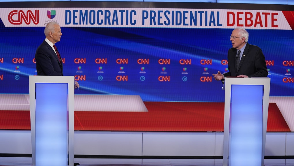 Sen. Bernie Sanders, I-Vt., and former Vice President Joe Biden, participate in a Democratic presidential primary debate at CNN Studios, in Washington