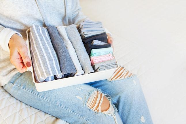 Order in wardrobe. Clothing neatly folded