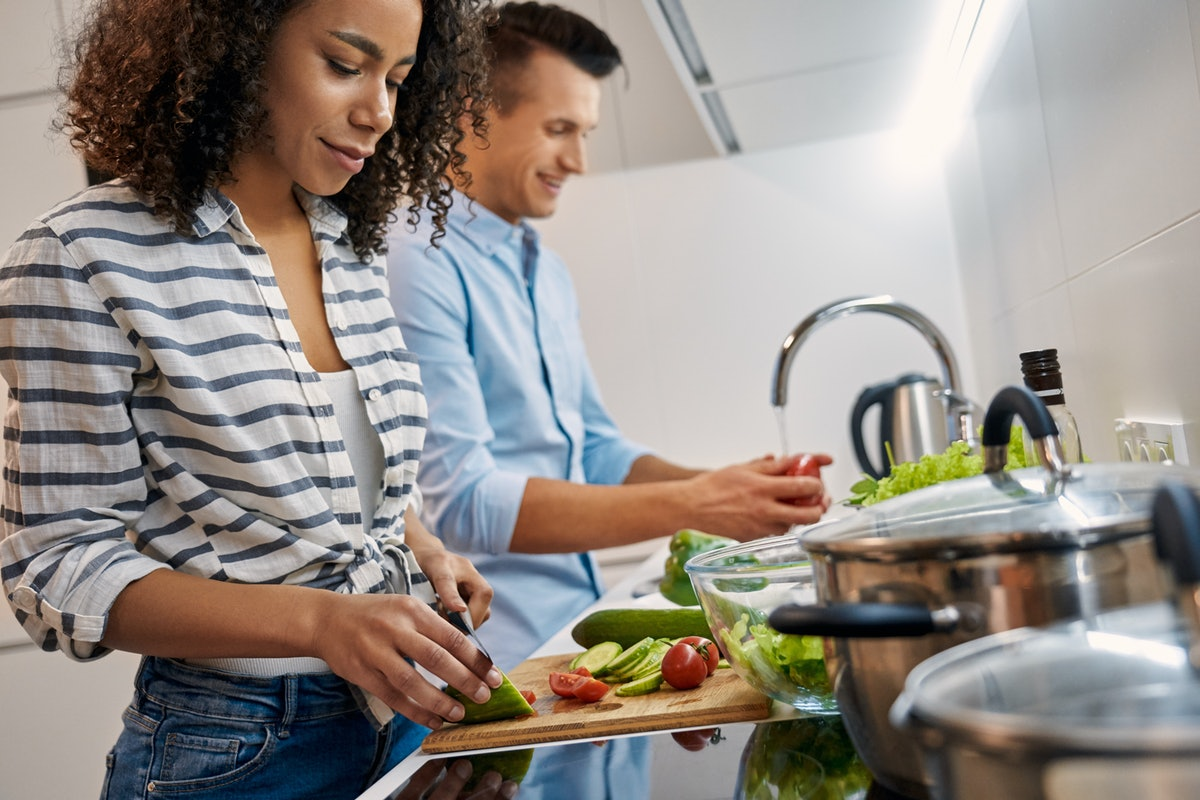 One of the many indoor date ideas is to compete in your own two-person cookoff.