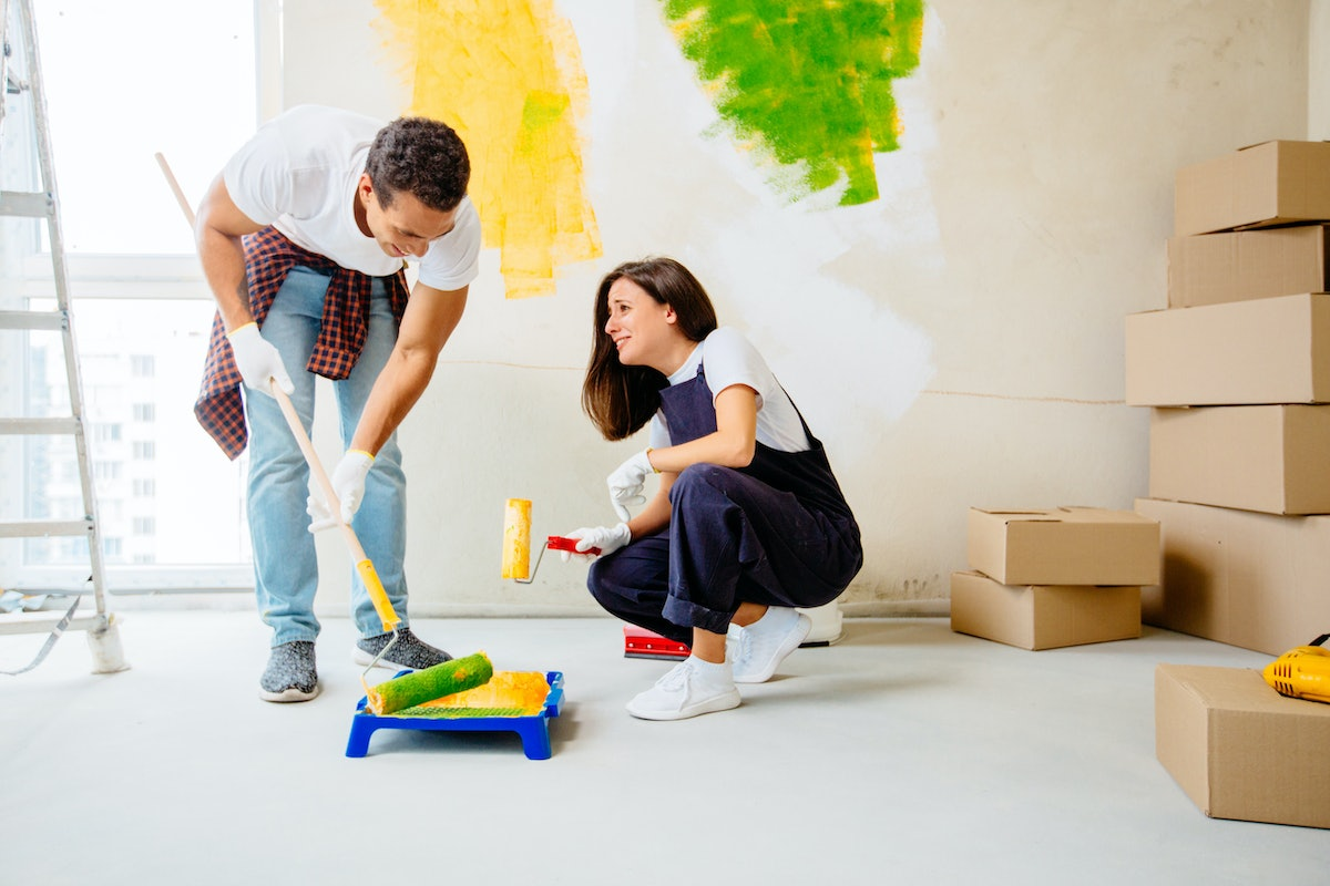 One of the best indoor date ideas is delving into a home improvement project, like painting a wall.
