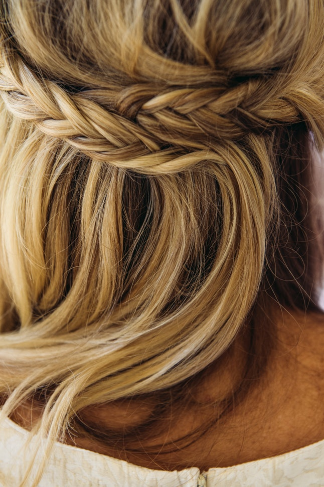 A cuacasian blonde woman close up of her braided hair.