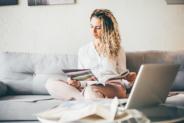 Woman designer working from home. Work from home concept.