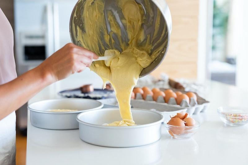 pouring vanilla batter into cake pan