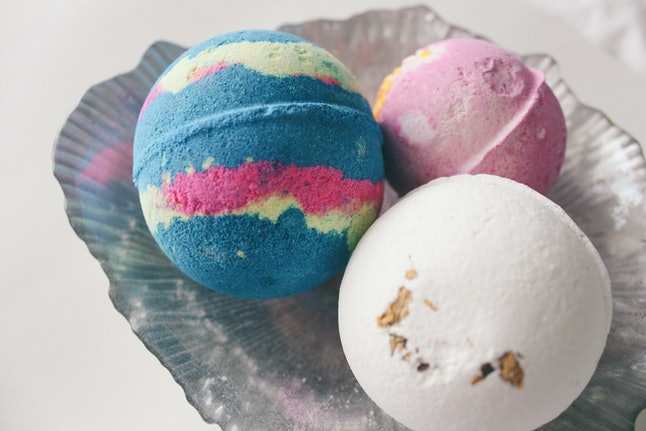 Bath bombs in grey tray against white background