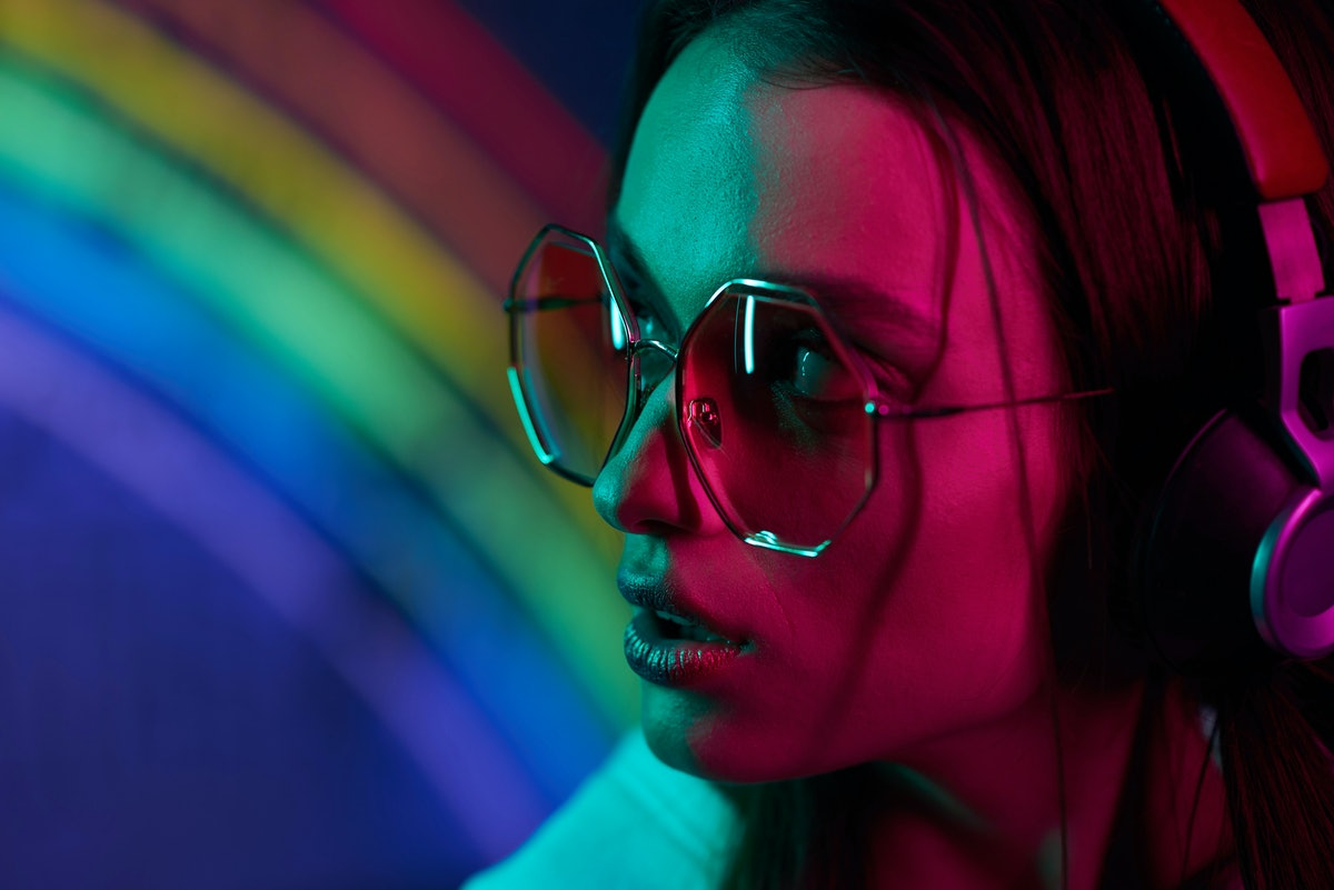 colored portrait of a beautiful young girl in neon light