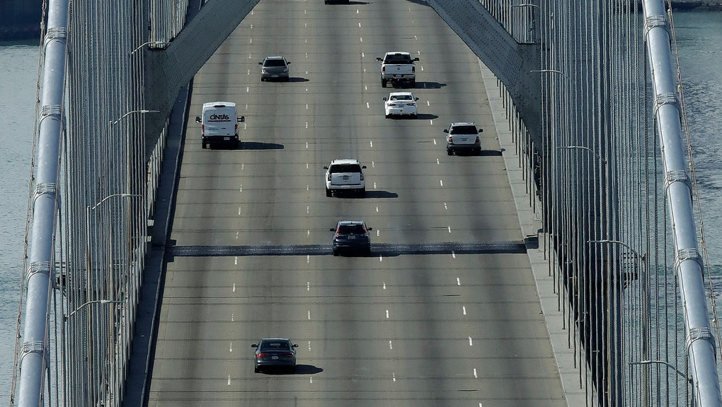 Motorists travel westbound on the San Francisco-Oakland Bay Bridge, in San Francisco. Officials in seven San Francisco Bay Area counties have issued a shelter-in-place mandate affecting about 7 million people, including the city of San Francisco itself. The order says residents must stay inside and venture out only for necessities for three weeks starting Tuesday