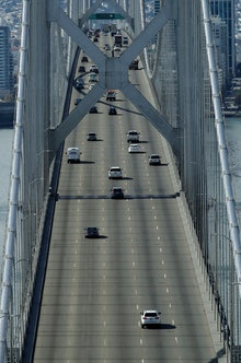 Motorists travel westbound on the San Francisco-Oakland Bay Bridge, in San Francisco. Officials in s...