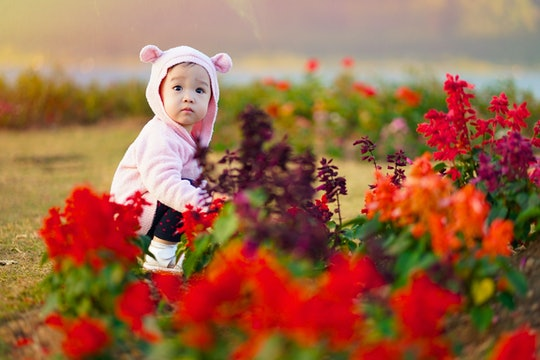 Baby girl in spring Flower Garden