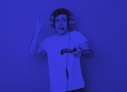 Teenager caucasian man using headphones and game controller
