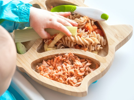 Baby eating salmon and pasta