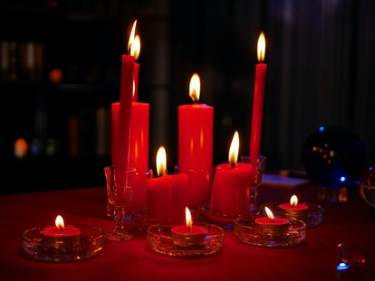 Mystical dark scenes of red burning candles for occult  divine magic for better luck for Chinese new year