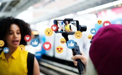 Vlogger streaming a live video live at a train platform