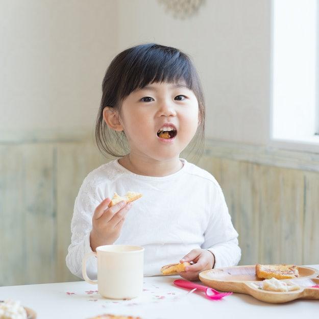 asian cute girl having breakfast
