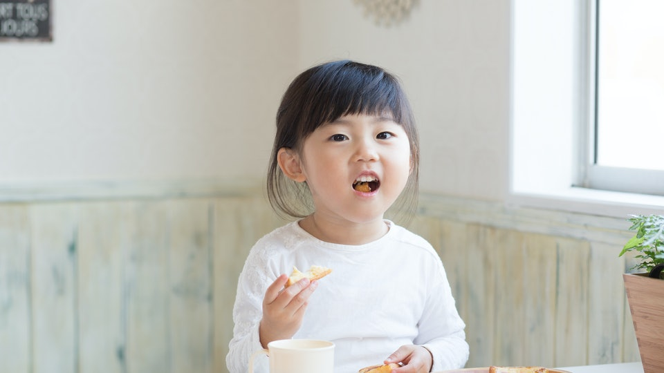 asian cute girl having breakfast