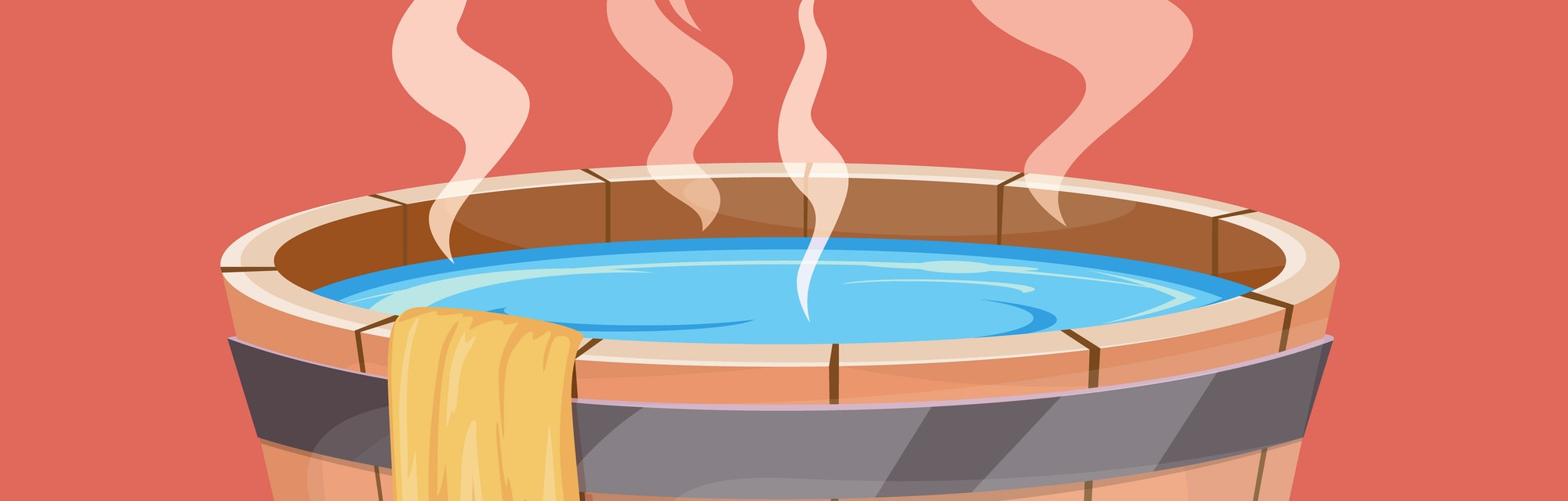 Wooden hot tub and towel