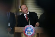 Graph, Colorado Gov. Jared Polis makes a point during a news conference about the state's efforts to...