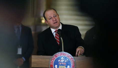 Graph, Colorado Gov. Jared Polis makes a point during a news conference about the state's efforts to fend off the spread of coronavirus in the Centennial State. On Monday, March 23, Polis signed a bill to abolish the death penalty and reduce the terms to life in prison for Colorado's three, death-row inmates