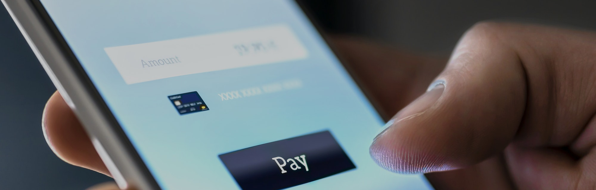 Mobile payment with wallet app and wireless nfc technology. Man paying and shopping with smartphone ...