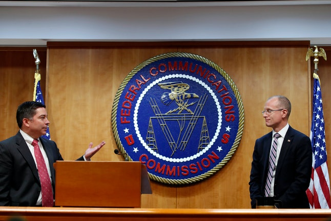 Brendan Carr, Michael O'Rielly. Federal Communications Commission (FCC) Commissioners Michael O'Rielly, left, and Brendan Carr, turn to answer a question from the media after an FCC meeting to vote on net neutrality, in Washington