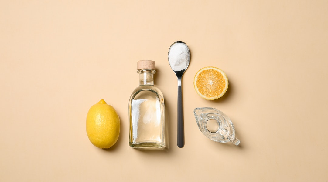 Flat lay composition with vinegar on color background