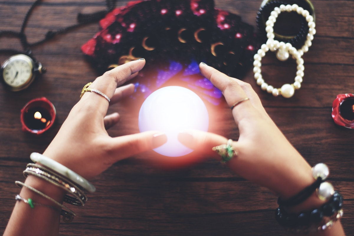 Psychic readings and clairvoyance concept / Crystal ball fortune teller hands and Tarot cards reading divination , Magic Spiritual and Horoscopes Occult