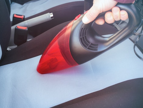 Car cleaning with handheld vacuum cleaner