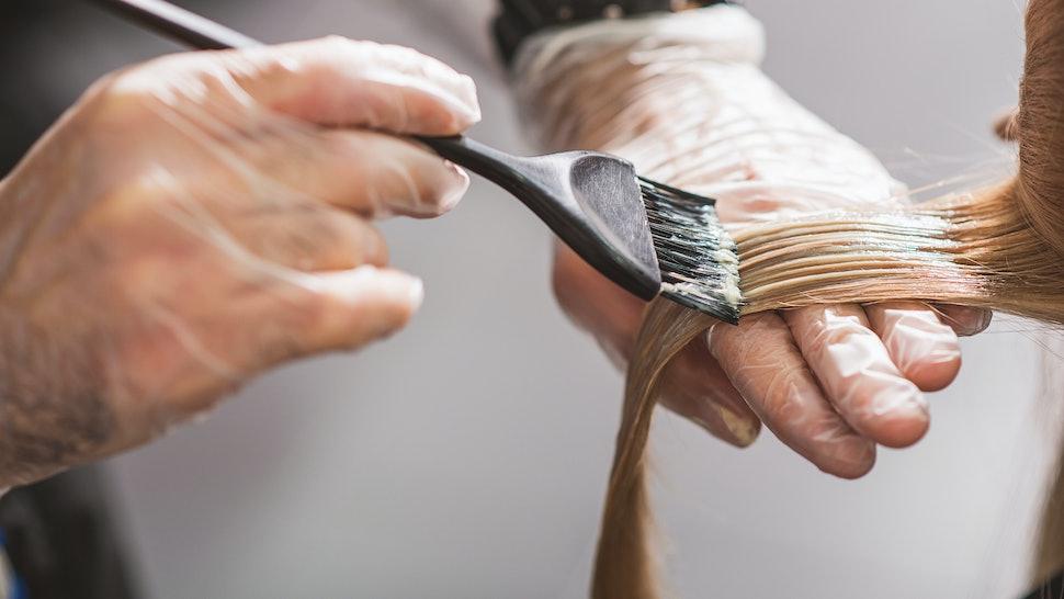Hairdresser is dying female hair