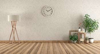 Empty room in retro style with floor lamp,books,plants om wooden floor - 3d rendering