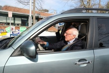 Democratic Presidential candidate and Vermont Senator Bernie Sanders and his wife Jane drive away af...