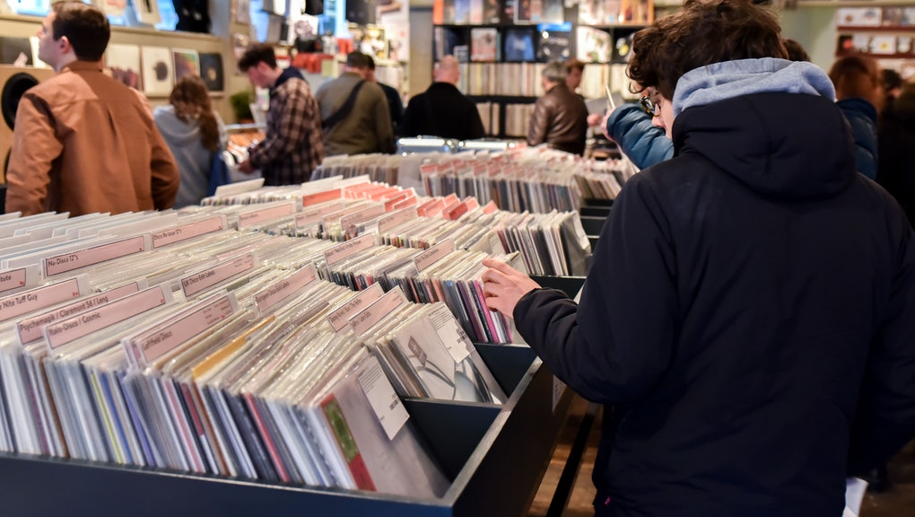 Vinyl record enthusiasts queue up for Record Store Day in Soho, London.