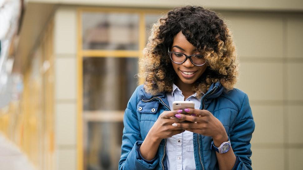 african american woman using phone