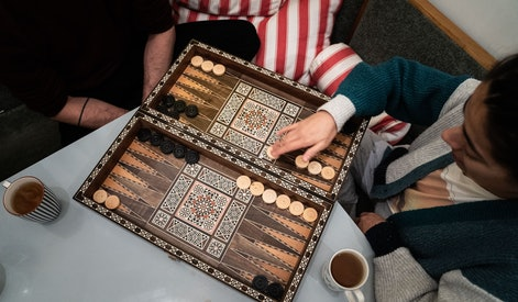 Roommates of Susanne Hassler-Smith and Thomas Smith play a board game in their shared flat in Vienna...