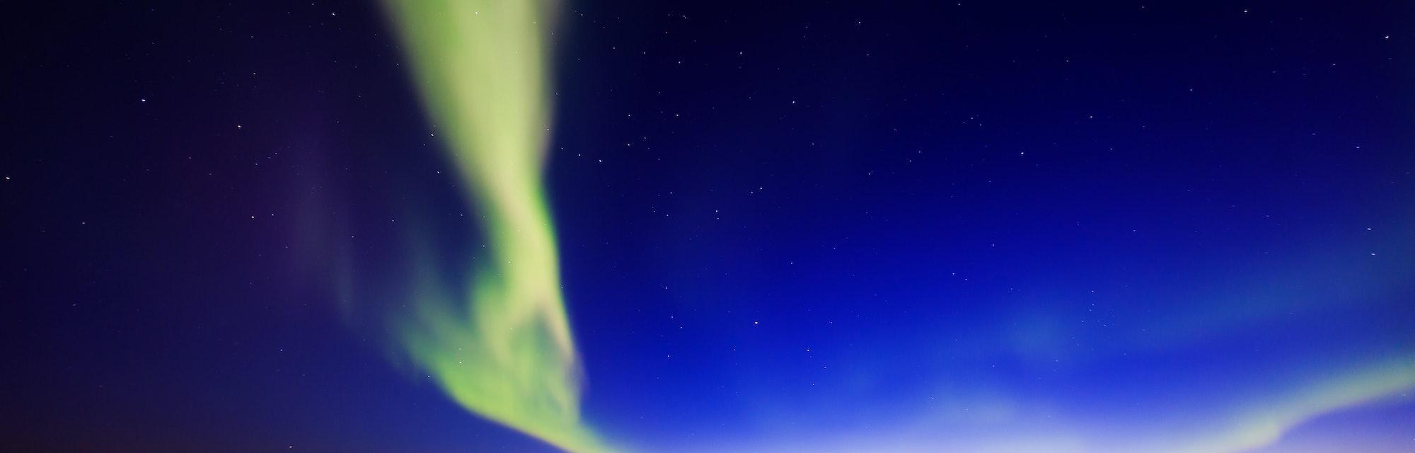 Beautiful picture of massive multicolored green vibrant Aurora Borealis, Aurora Polaris, also know a...