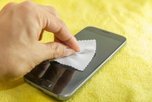 cleaning mobile phone screen by microfiber cloth. Before apply the smart phone screen protect flim