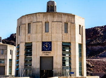 Hoover Dam, border of Arizona & Nevada. Hoover Dams Arizona clock on intake tower.
