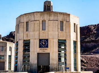 Hoover Dam, border of Arizona & Nevada. Hoover Dams Arizona clock on intake tower.