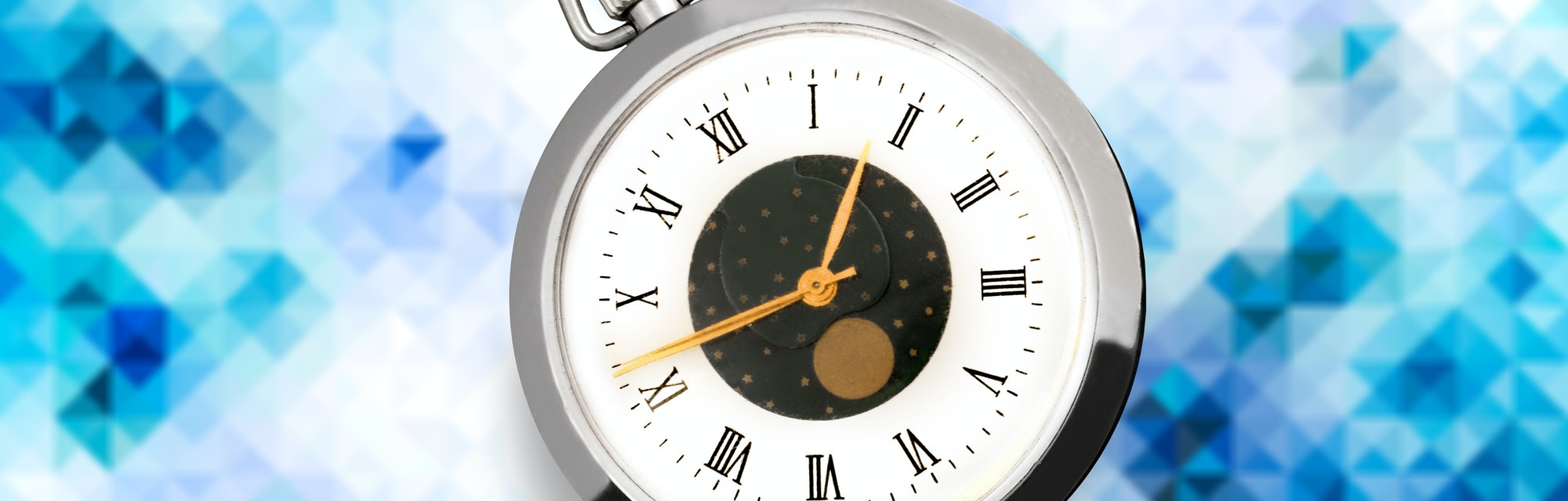 The classic silver clock on abstract background