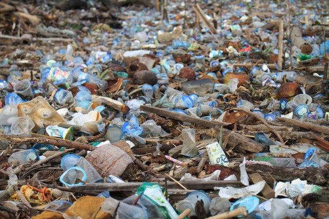 Piles of plastic waste cover the river as it flows into the sea