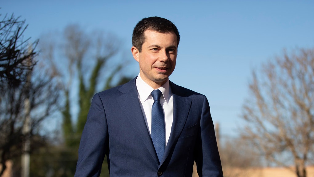 Democratic presidential candidate and former South Bend, Ind. Mayor Pete Buttigieg walks to speaks with members of the media, in Plains, Ga
