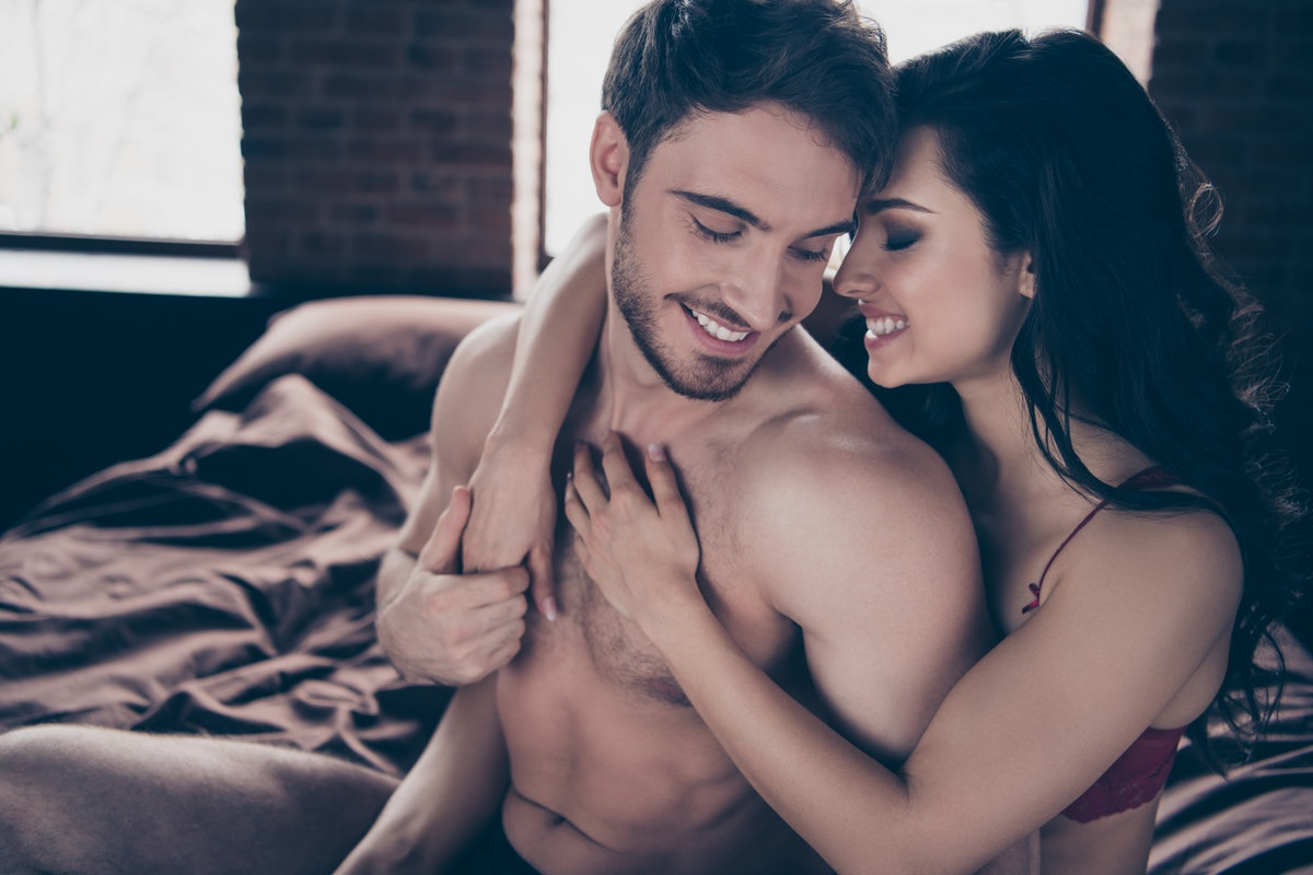 Portrait of her she his he two nice sweet lovely attractive winsome fascinating luxury cheerful people married spouses glamorous lady hugging guy's back having fun at industrial loft interior room