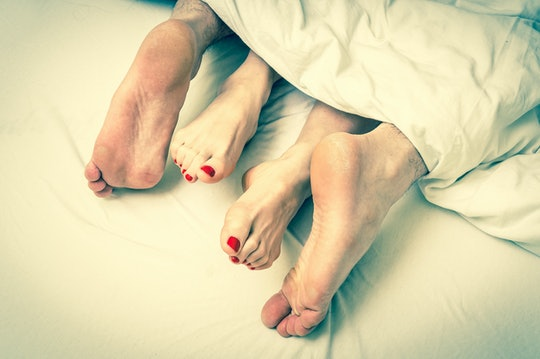 close up of couples' feet during intimacy