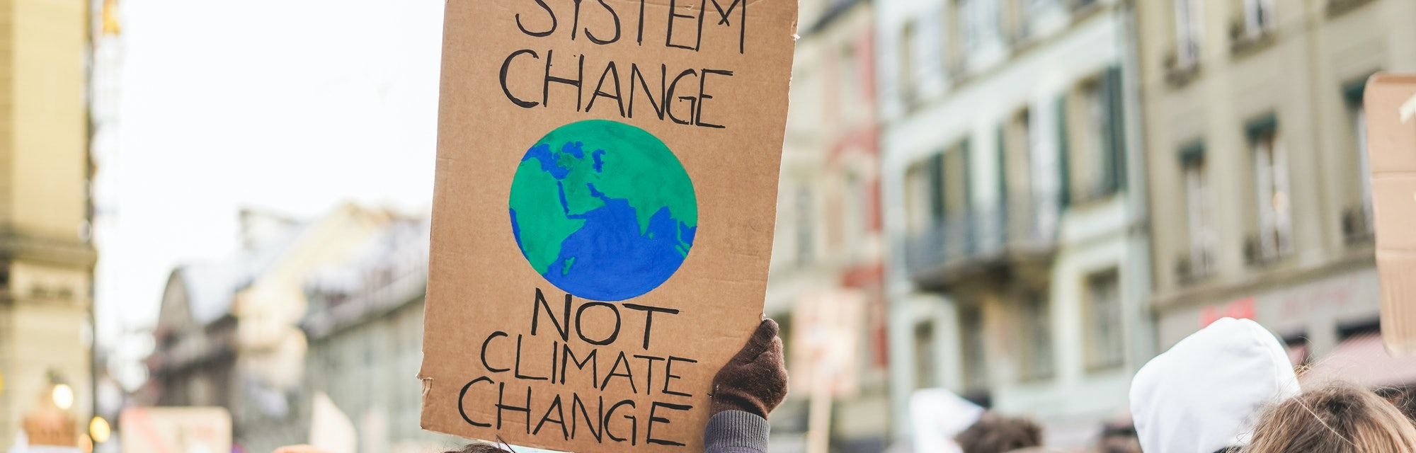 Group of demonstrators fight for climate change - Global warming and enviroment concept - Focus on banner