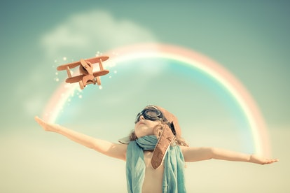 happy kind with a rainbow behind him