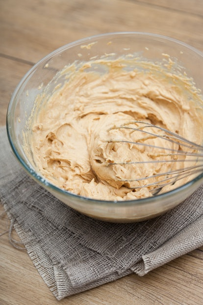 Blend in the peanut butter and milk with the other dry ingredients.