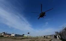 Iraqi military helicopters fly over the Al-Taqaddum Airbase (Habbaniyah), western Baghdad, Iraq on 0...