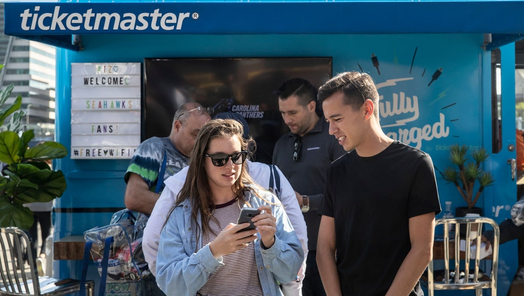 Ticketmaster helps fans get their digital tickets ready on their on mobile devices for the Seahawks home opener at CenturyLink Field, in Seattle
