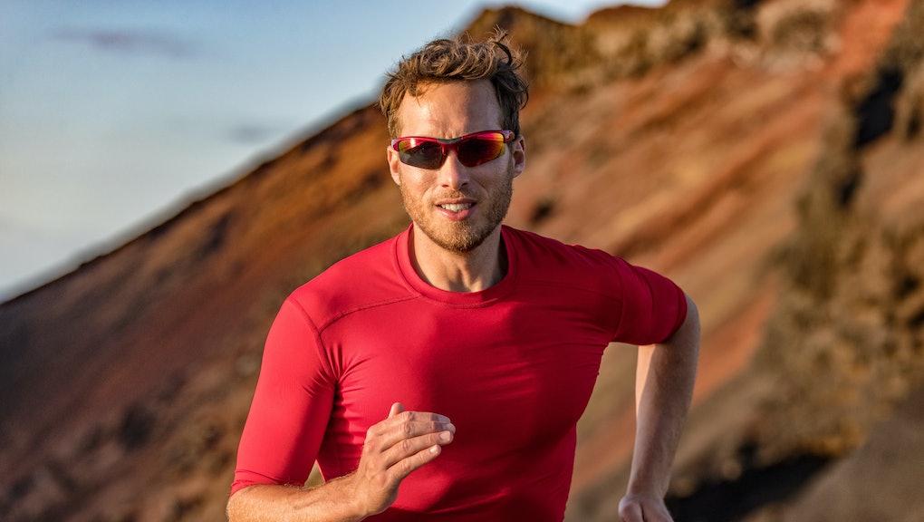 Athlete runner trail running in mountains nature. Sport active fitness ultra trail, run marathoner t...